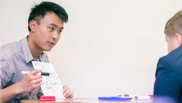 The Tutor Trust, tutor teaching maths to a student